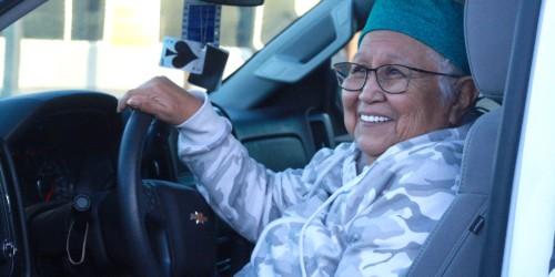 Elder 'U'nihi-ya (Catherine) Jim sits in her truck as she speaks to journalist Julie Chadwick about the Elder literacy program.